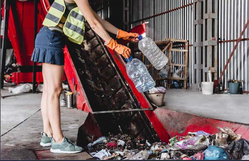 woman sorting rubbish for recycling